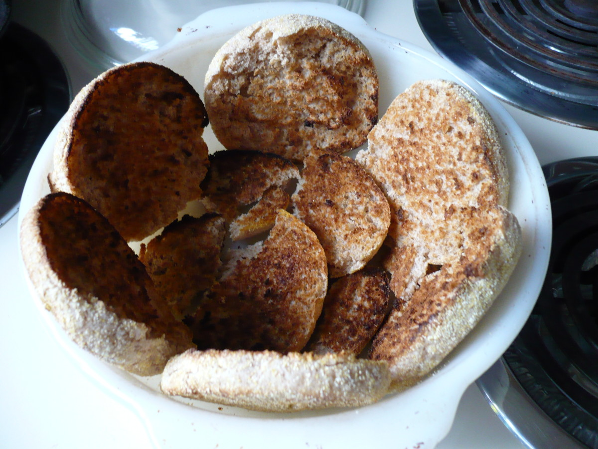 Toast english whole wheat muffins and grease oven ware dish with lots of olive oil so the slices don't stick when serving them.