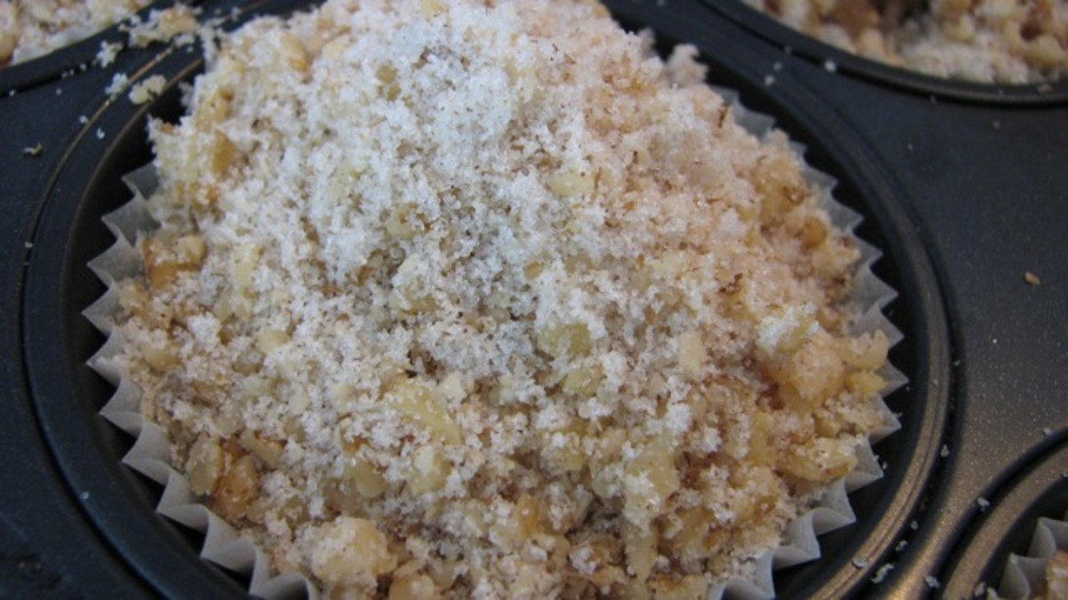 Crunchy topping pressed into the tops of the strawberry muffins before baking.