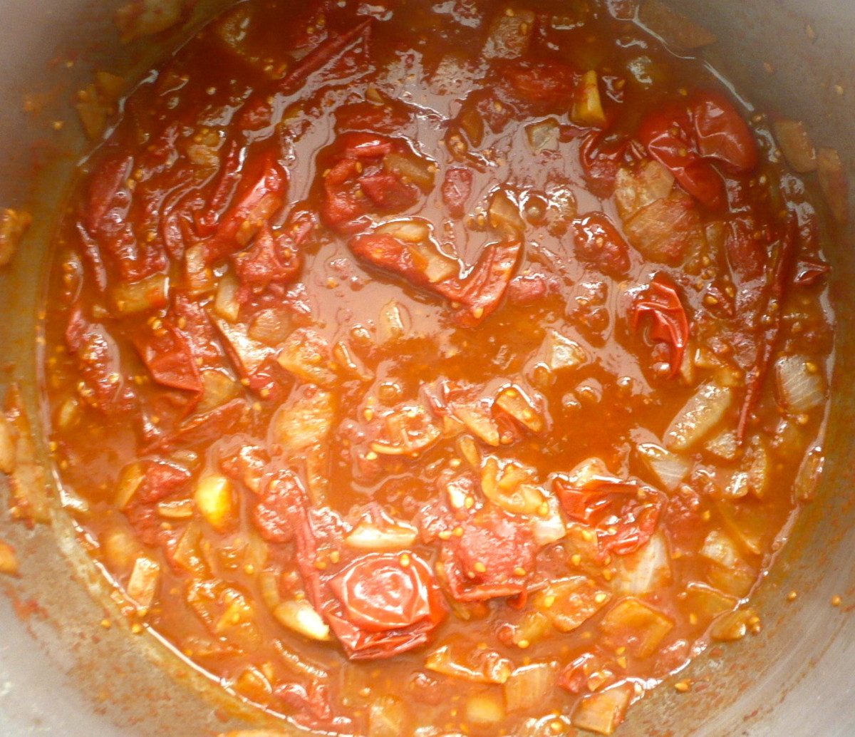 Cook the sauce until the tomatoes are soft.
