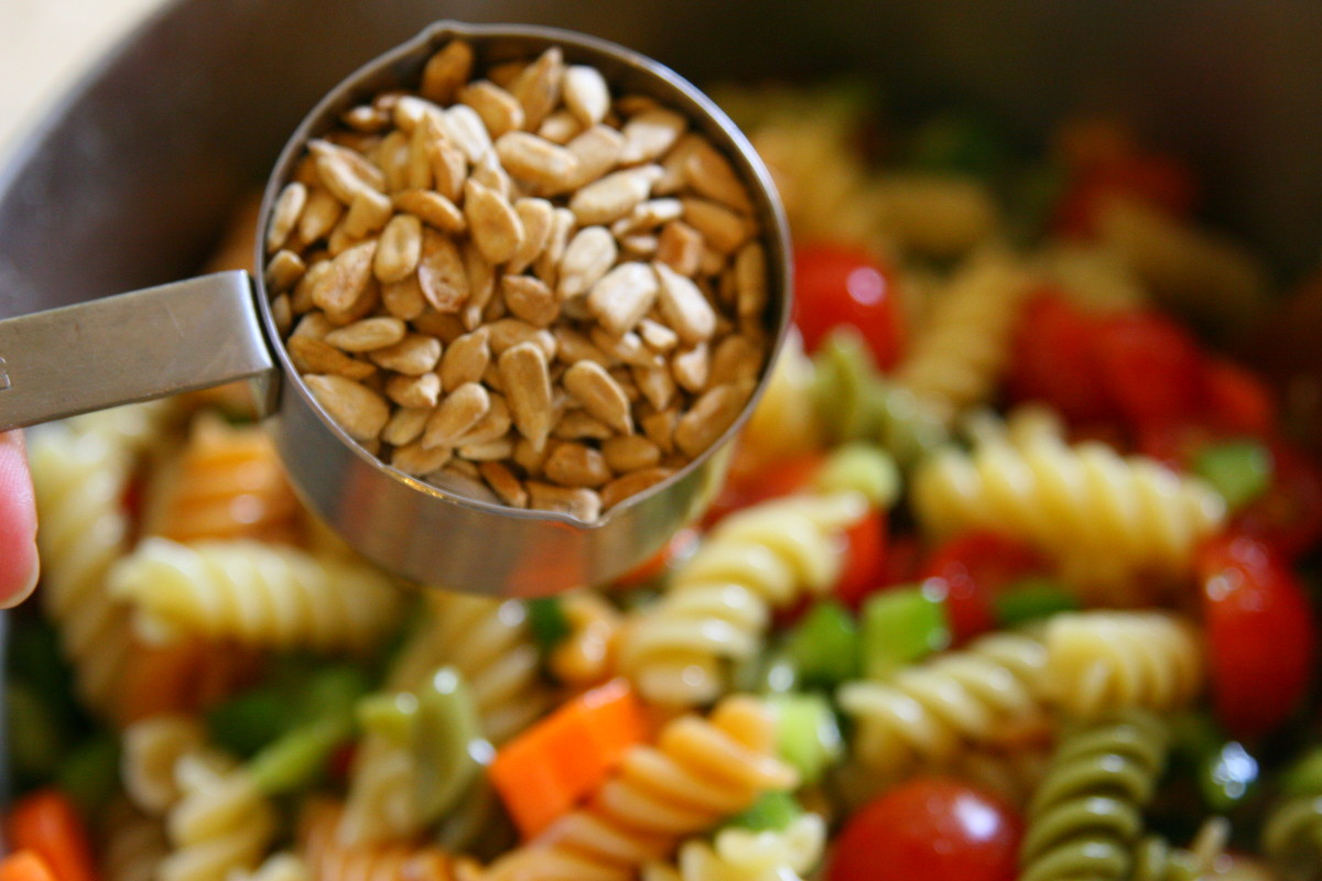 Add the seasoned sunflower seeds and the Italian dressing to the salad. Stir to combine the ingredients and store in the refrigerator for up to 1 week.