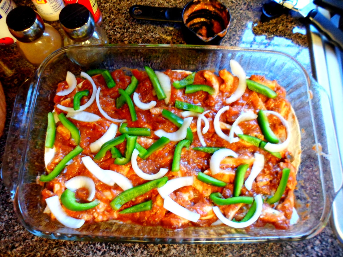 Sprinkle half of the green peppers and onions on top of mixture.