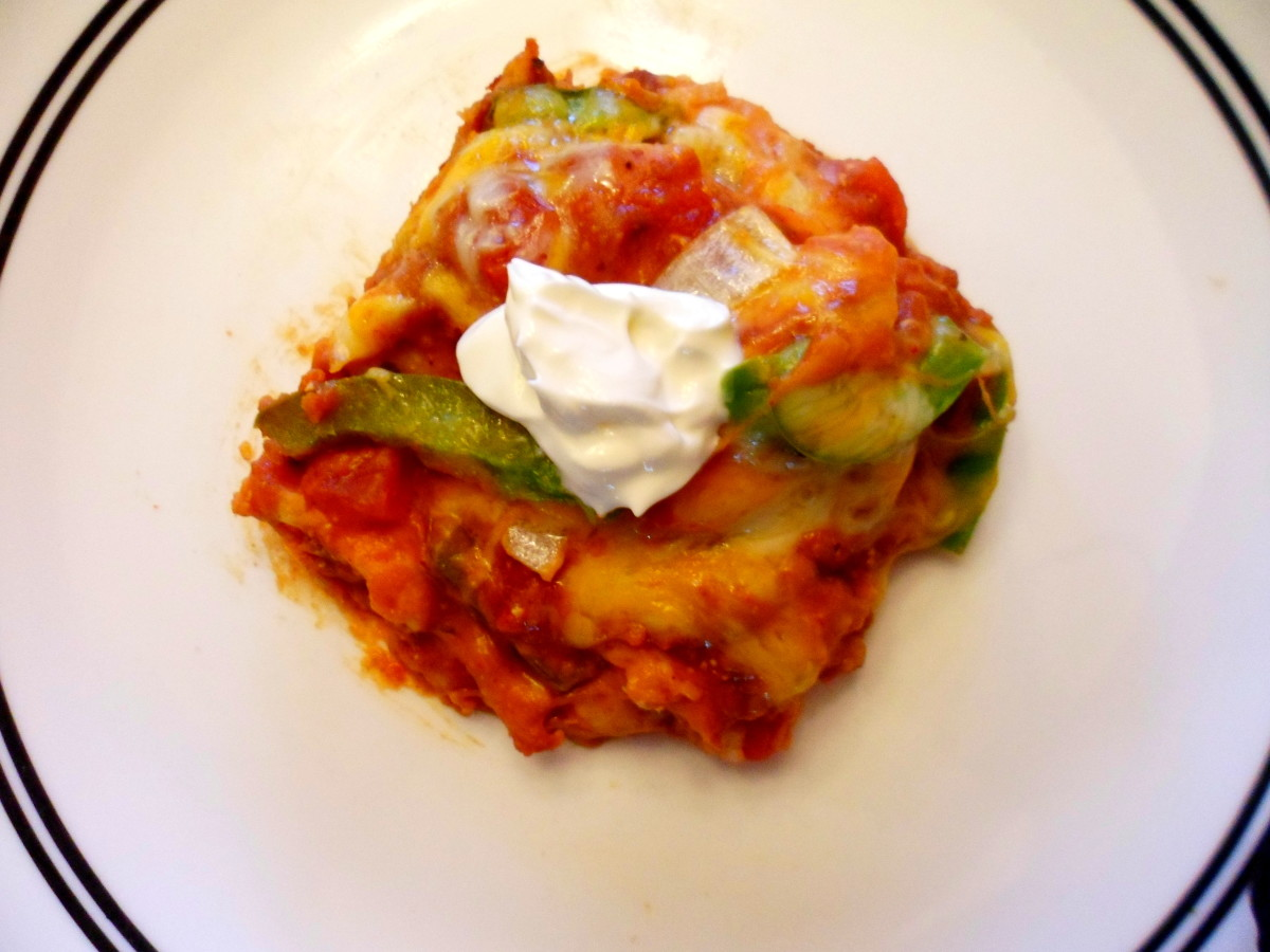 A serving of chicken fajita casserole with sour cream.