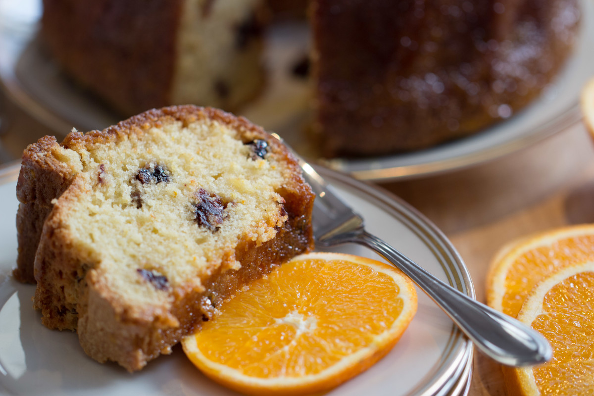 Orange cranberry bundt with a slice of fresh orange.