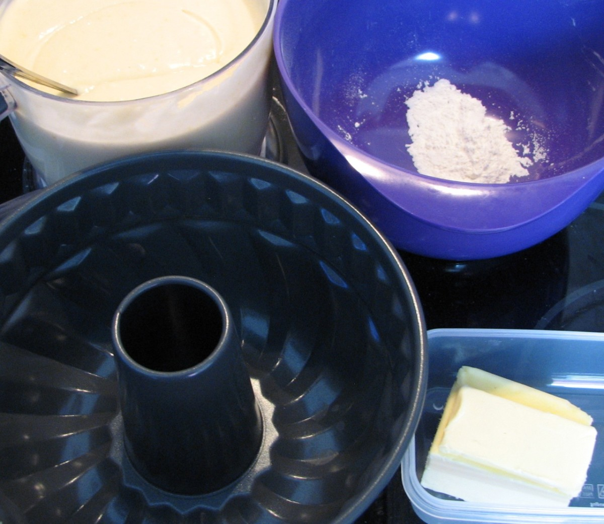 Butter and flour a large cake tin - a Bundt tin is especially beautiful.