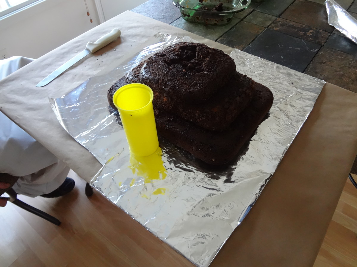 Find a cup that will fit in the cake for the lava.
