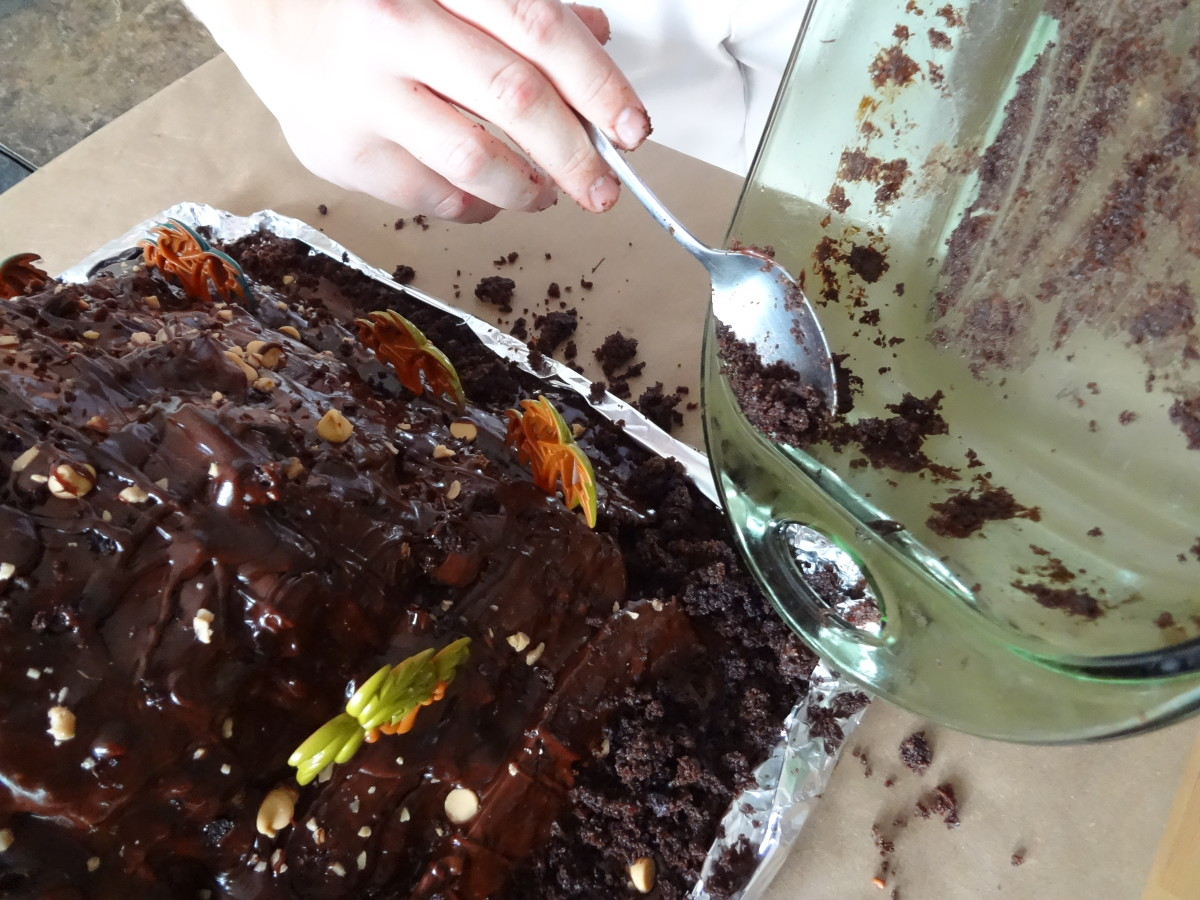 "Use left over cake or crumbled cookies to fill in ""dirt"" over the aluminum foil."