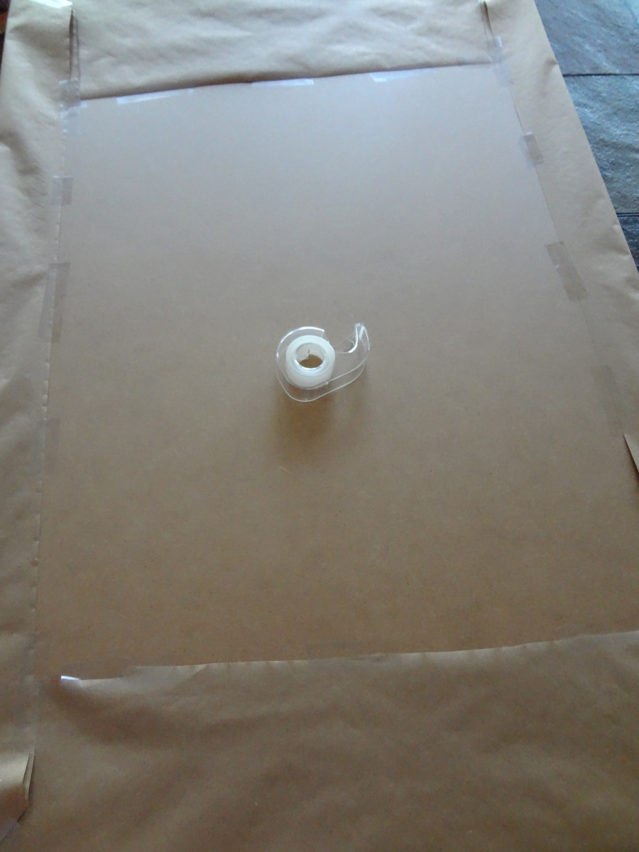 Tape the paper to the underside of the board.