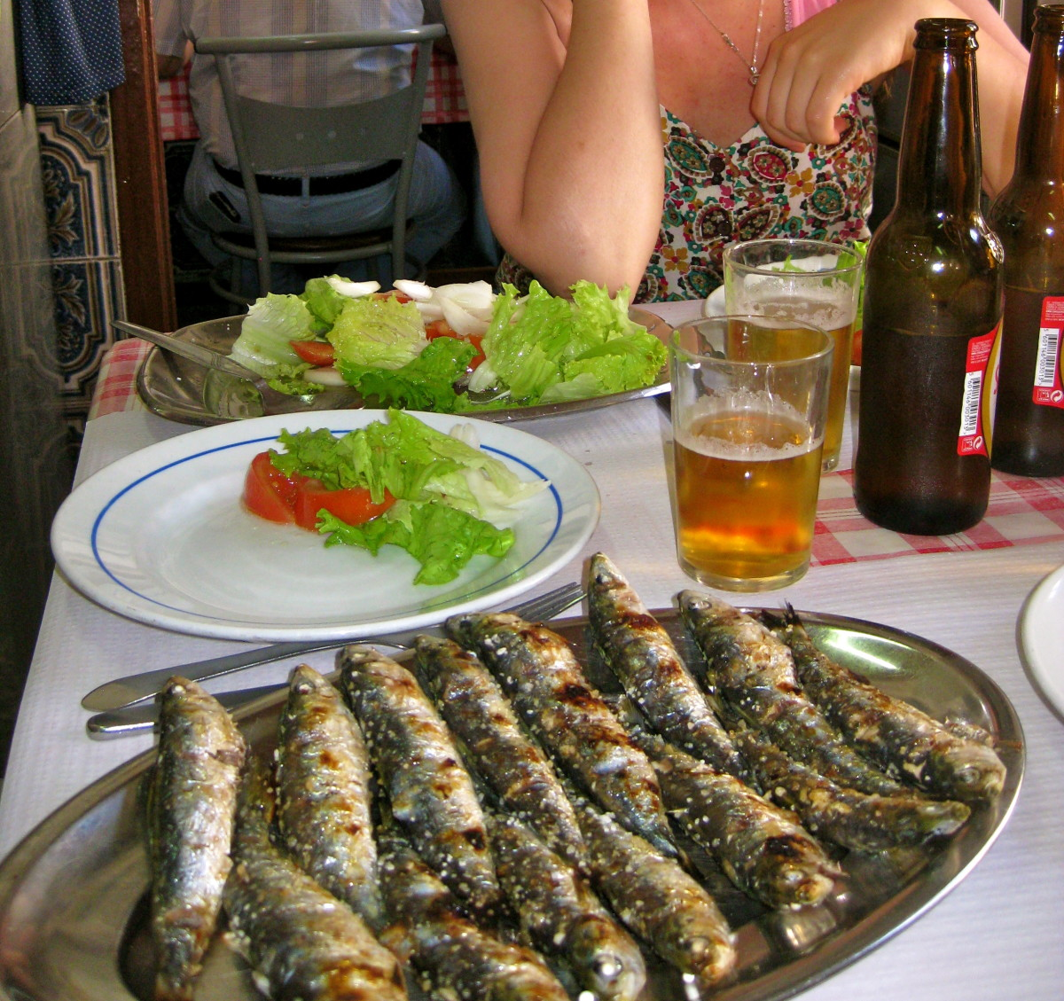 Grilled sardines are best served with a cold Portuguese beer like Sagres.