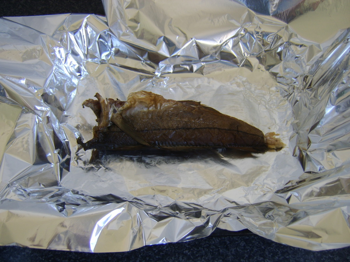 Arbroath smokie is laid on lightly buttered foil