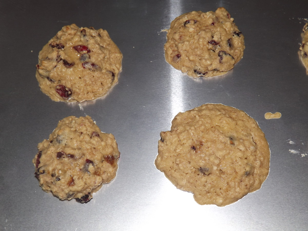 Cookies cooling on a cookie sheet.