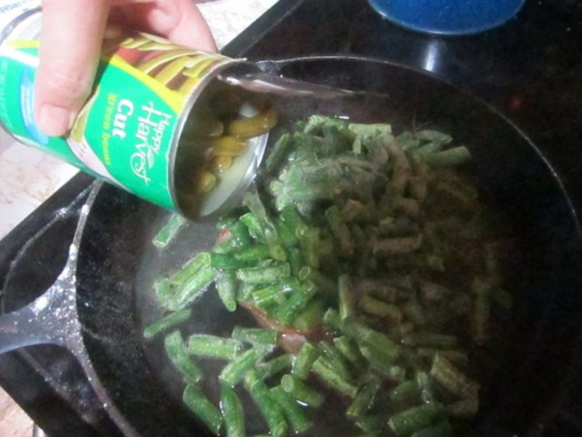 Add entire contents of one can of green beans to frozen ones.