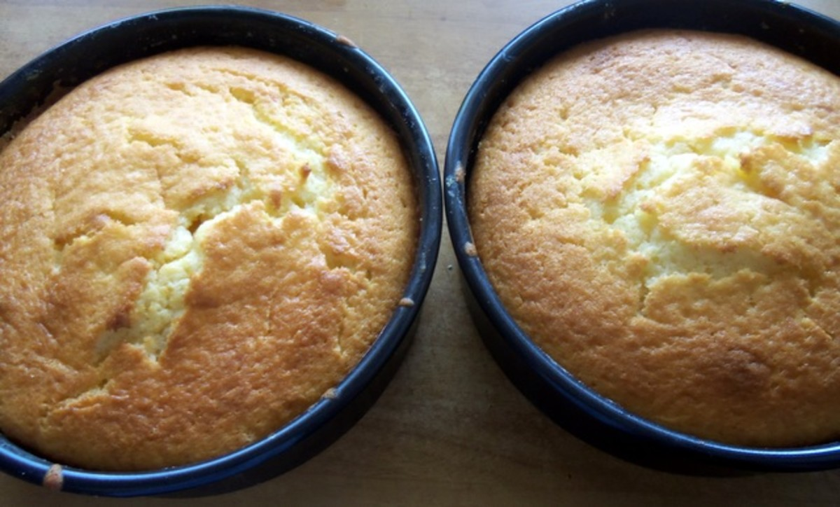 When ready, leave to cool in the tins for 5 minutes.  The cake should be golden brown and springy to the touch.