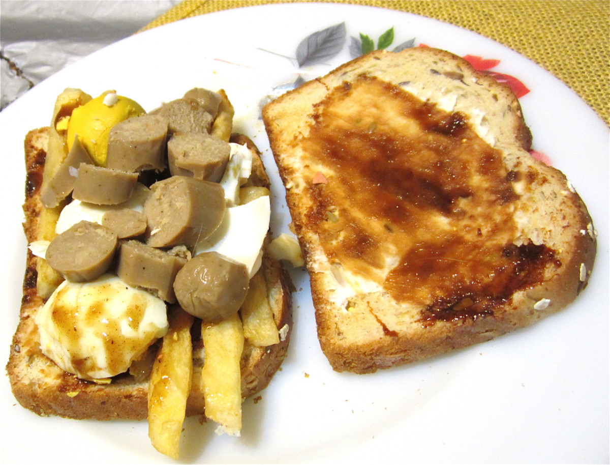Textured vegetable protein sausage with egg, French fries, and marmite.