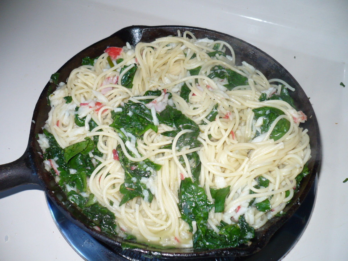Pour pasta into the same pan you sautaed the crab,garlic,butter,spinach,and olive oil in and mix together.