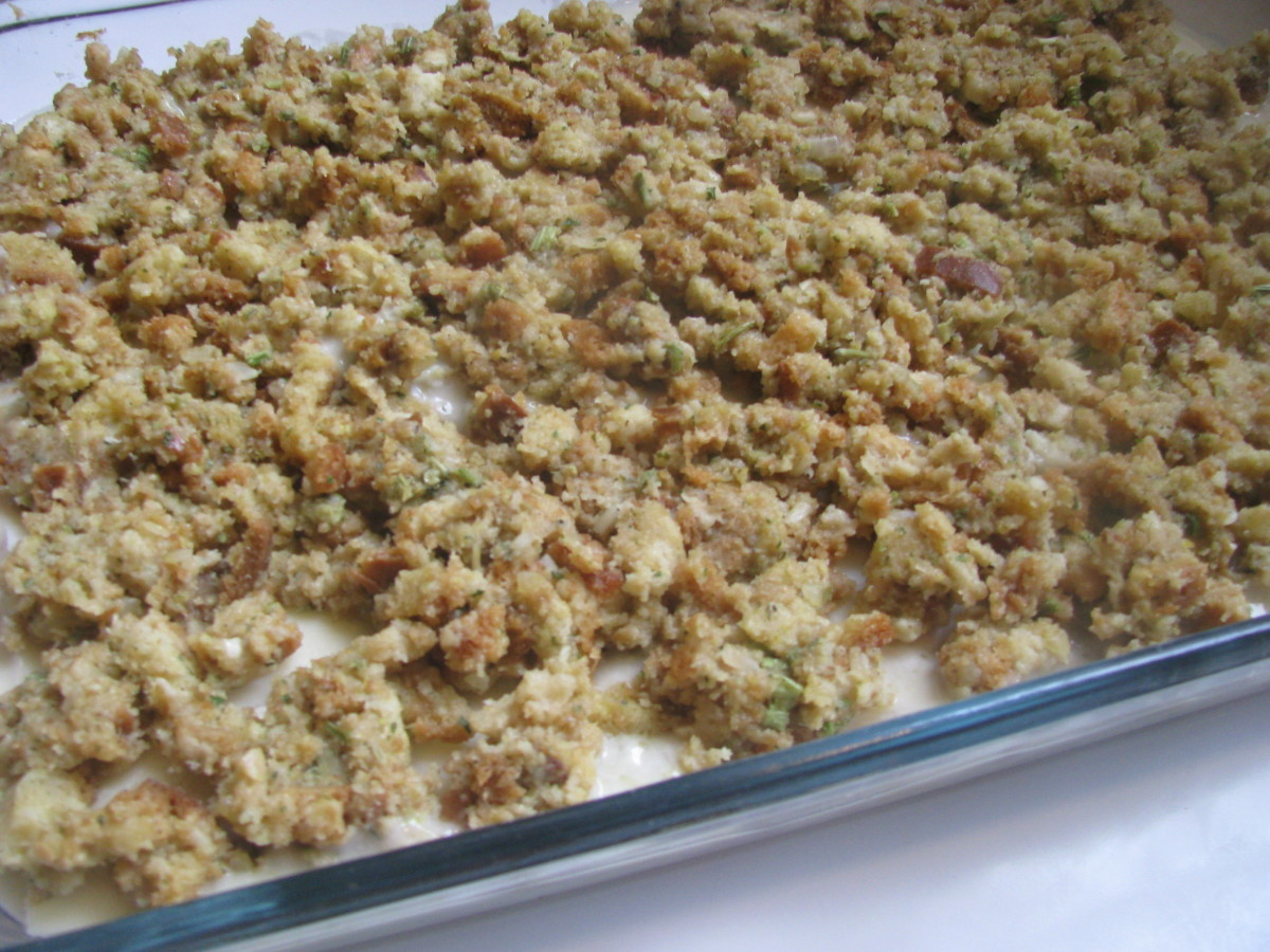 Place prepared stuffing mix on top of Swiss cheese