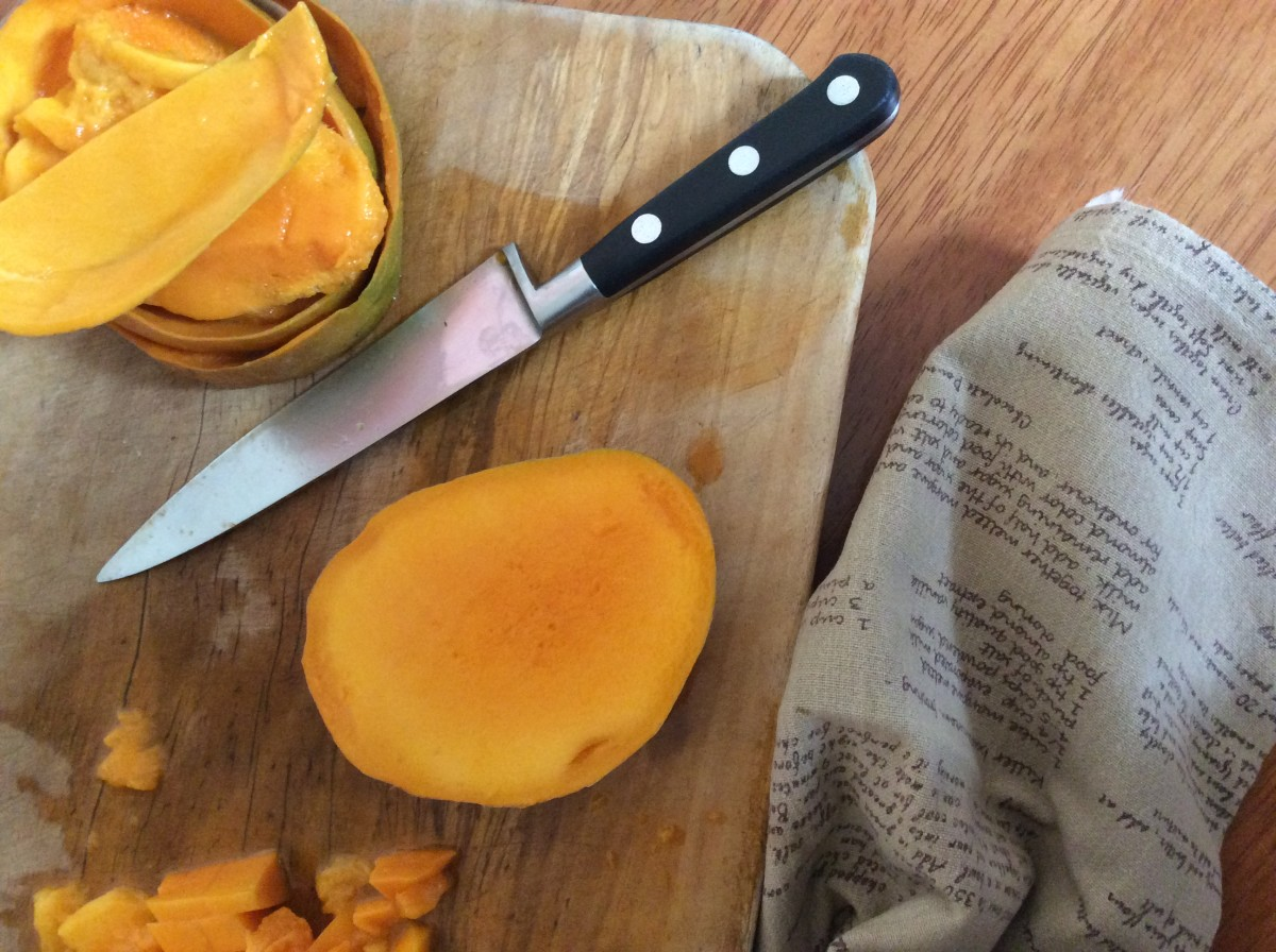 Split the mangoes and cut out the flesh dicing it up into small chunks.