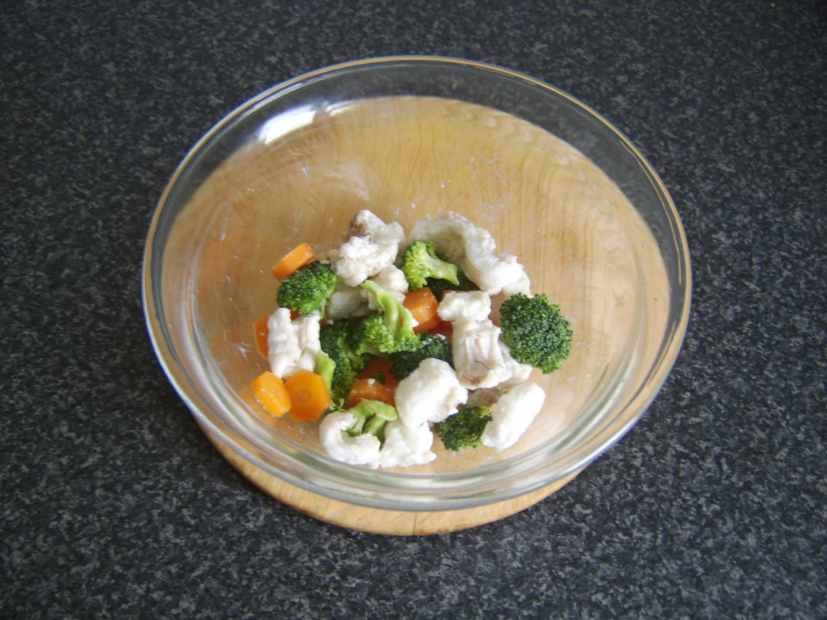 Carrot, broccoli and poached ling are mixed together