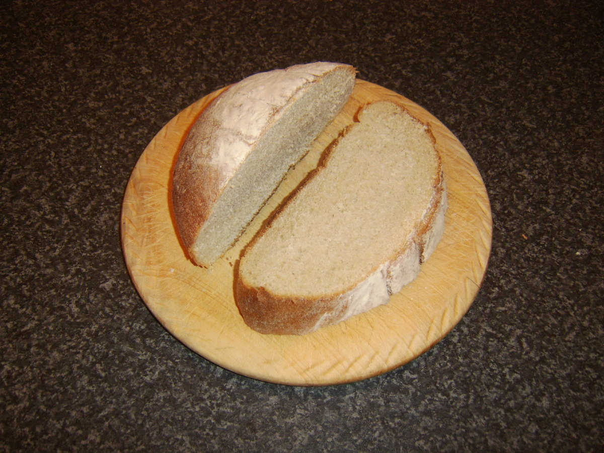 Artisan boule slice is cut for toasting