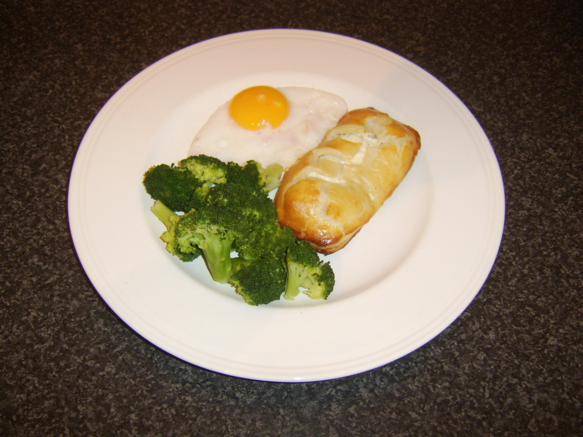 Ling fillet is wrapped and cooked in puff pastry before being served with a pan fried duck egg and some fresh broccoli