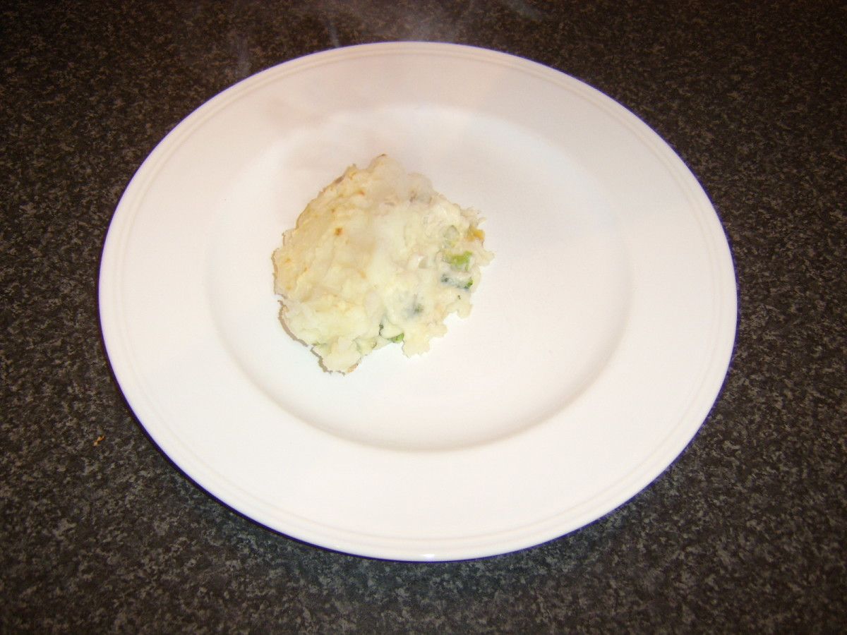 Portion of ling fish pie is plated