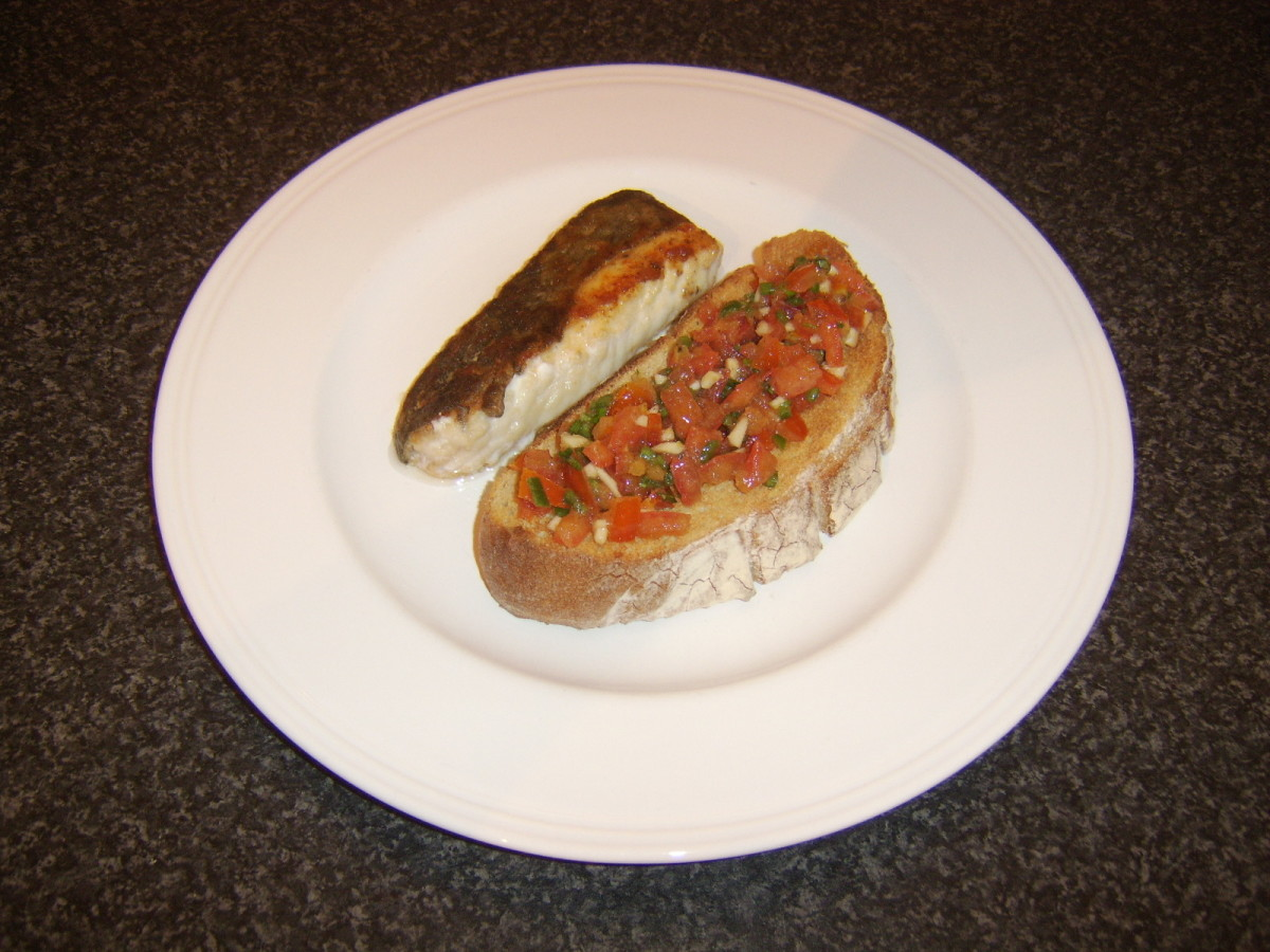 Pan fried ling fillet is served simply with some thick toast and a moderately spicy salsa