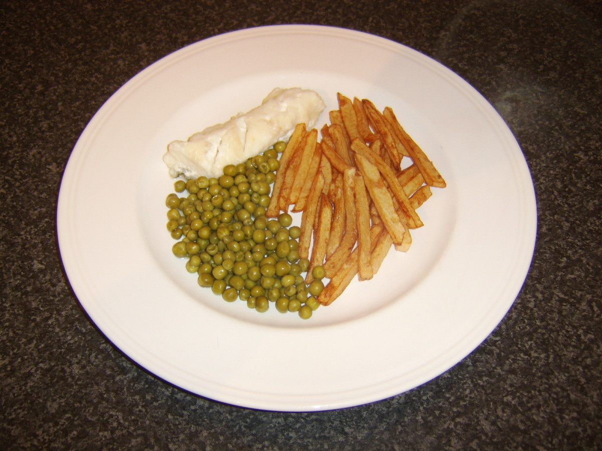 Ling, fries and peas are plated