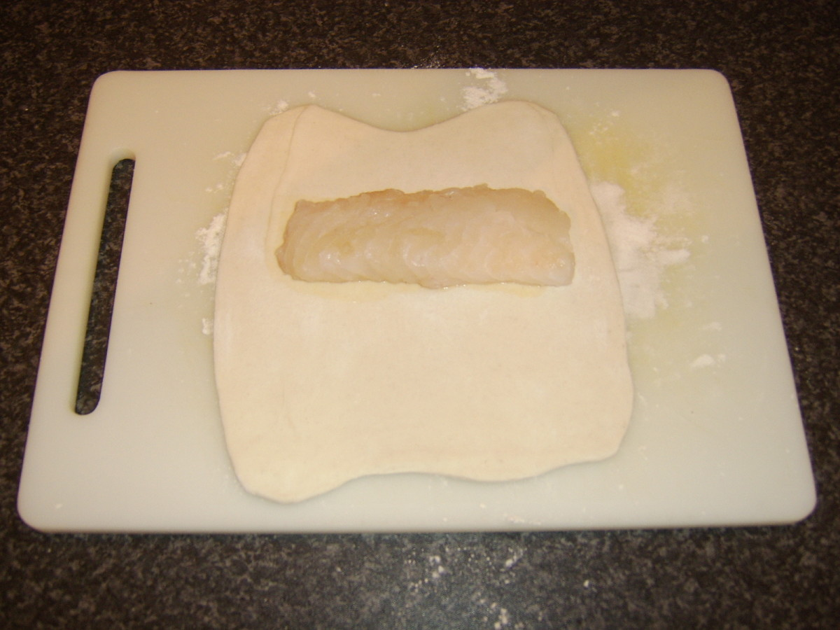 Ling fillet is laid on puff pastry