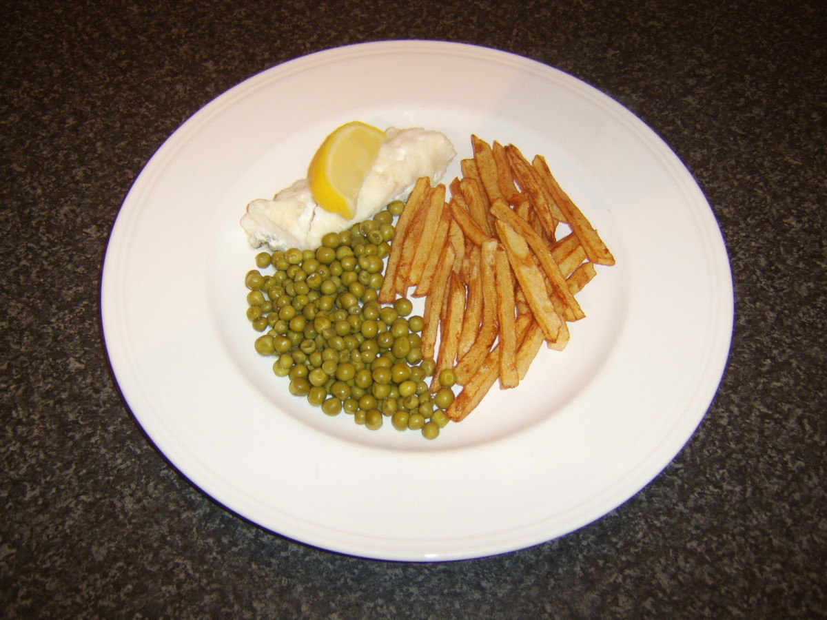 Ling fillet is baked in the oven and served with homemade fries (micro chips) and garden peas
