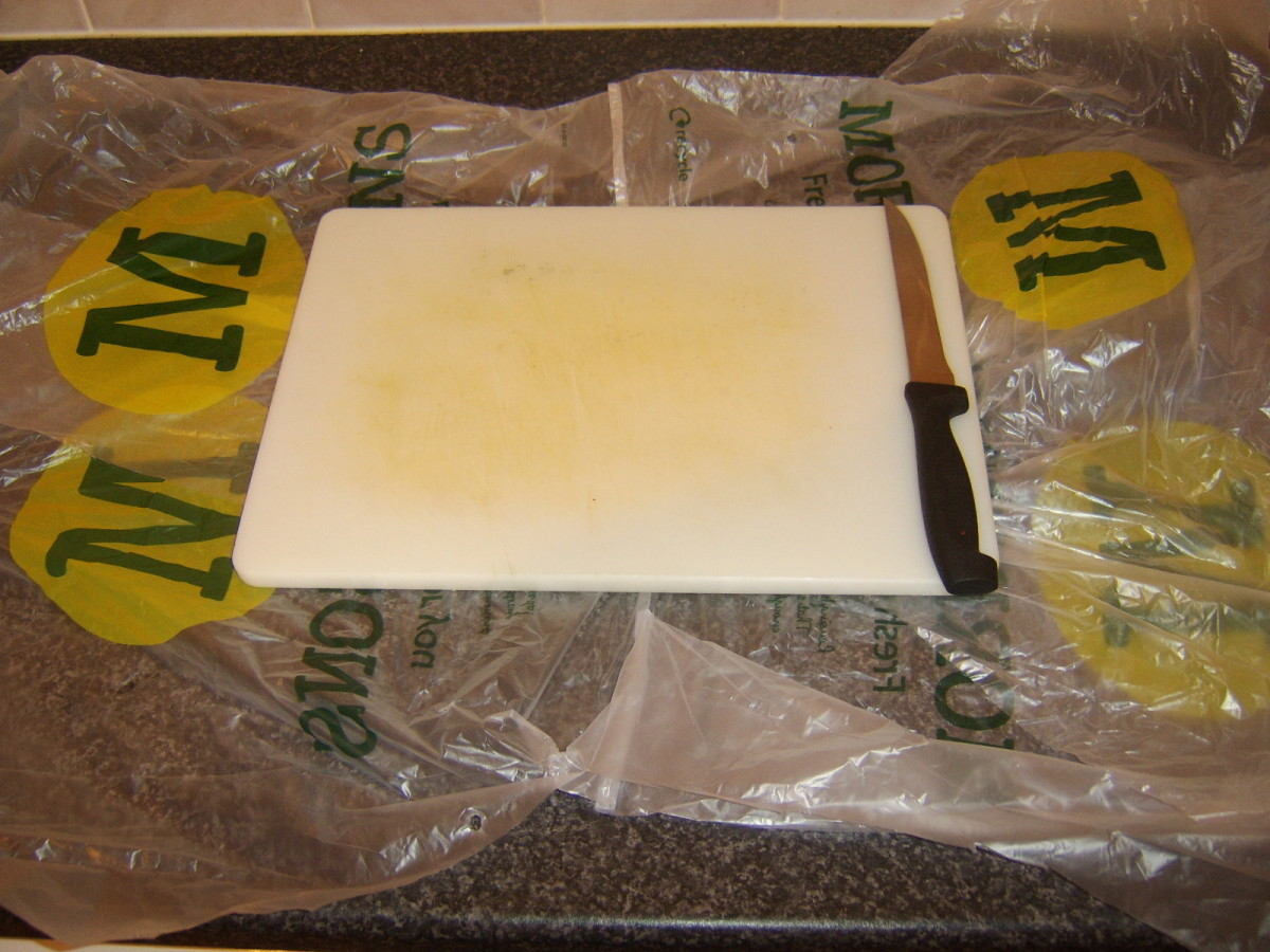 Plastic bags make clearing up easier after the ling is filleted