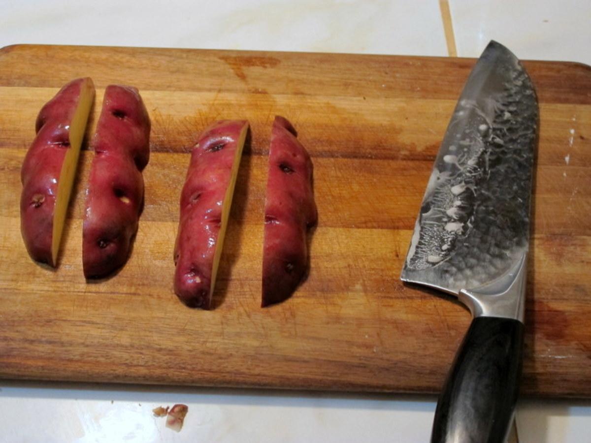 Slice each half lengthwise again