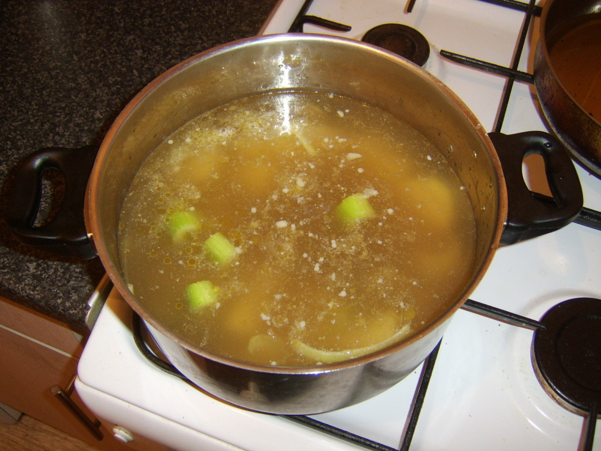 Beef stock is poured in to the vegetable mix