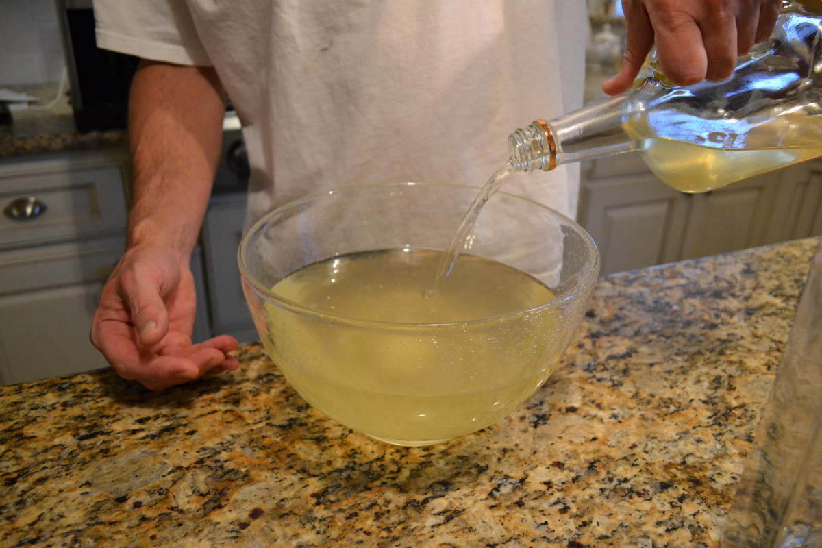 Step 8: Pour the vodka from the bottle into the bowl to mix flavors evenly.