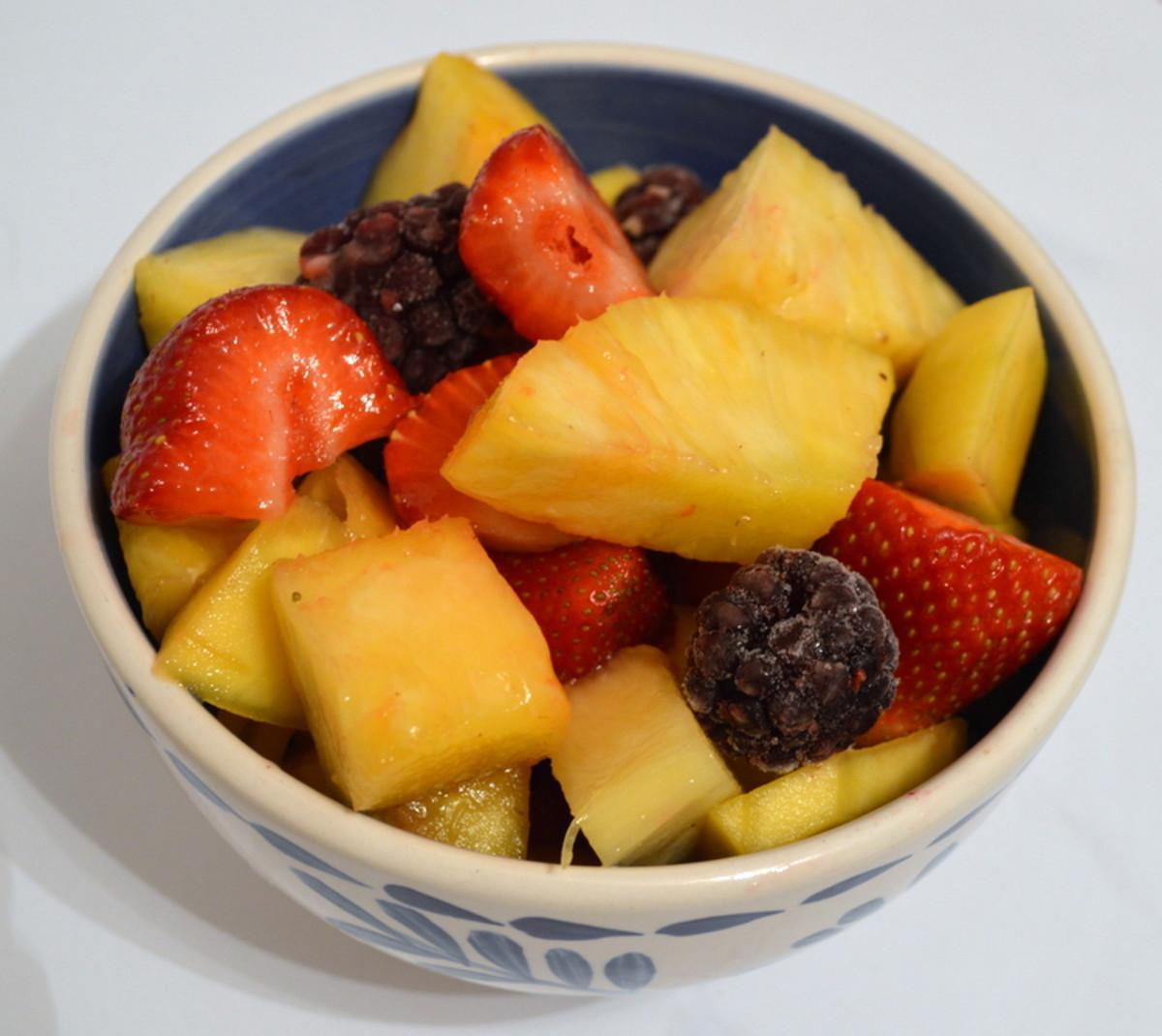 Mango, pineapple, strawberries, and blackberries in a tasty fruit salad.