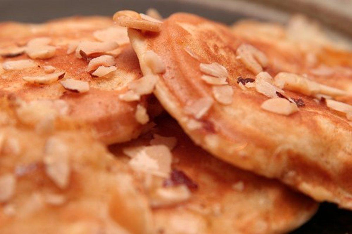 Granola and sugar-free syrup make for a semi-healthy pancake breakfast.