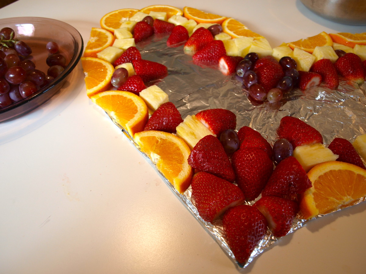 Start assembling the fruit in a decorative pattern of your choice.