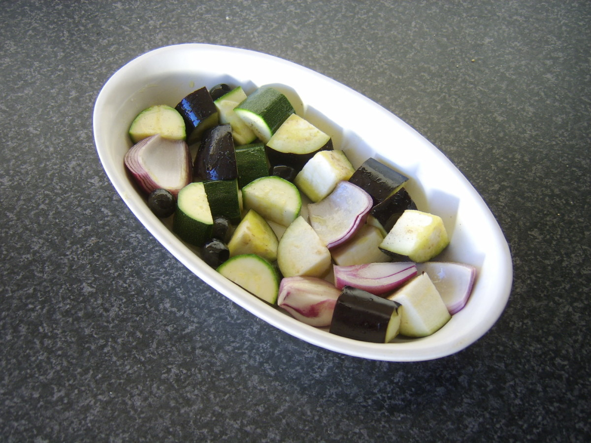 Mediterranean vegetables are seasoned and stirred in olive oil for raosting