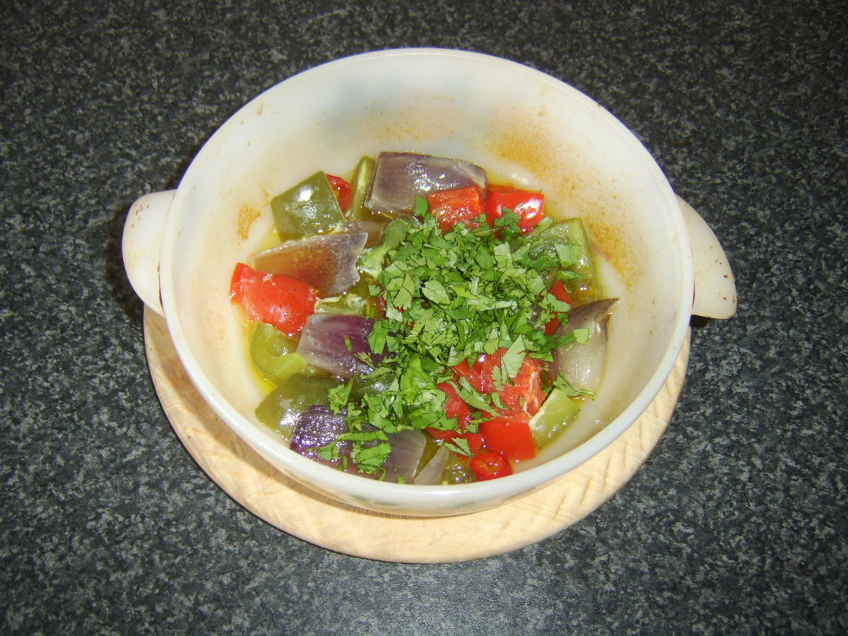 Chopped coriander/cilantro is added to the casseroled vegetables