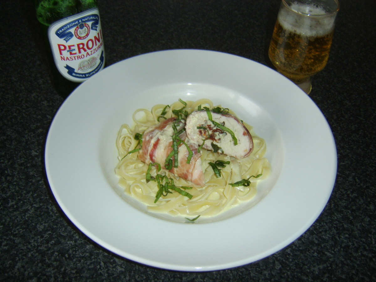 Stuffed chicken breast and linguine is served with Peroni Italian beer