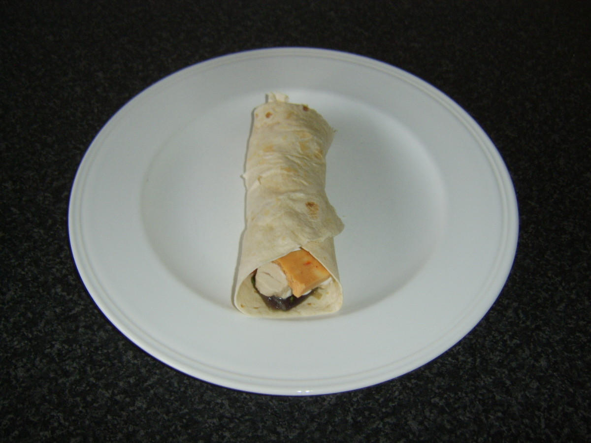 Ready to eat spicy pork stuffed chicken tortilla wrap