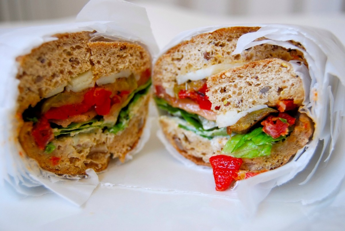 """Vegetarian sub: Japanese Eggplant, Artichoke Hearts, Sun Dried Tomatoes, Roasted Red Peppers, Mozzarella Cheese, Lettuce & """"Goddess Dressing"""" on wheat."""