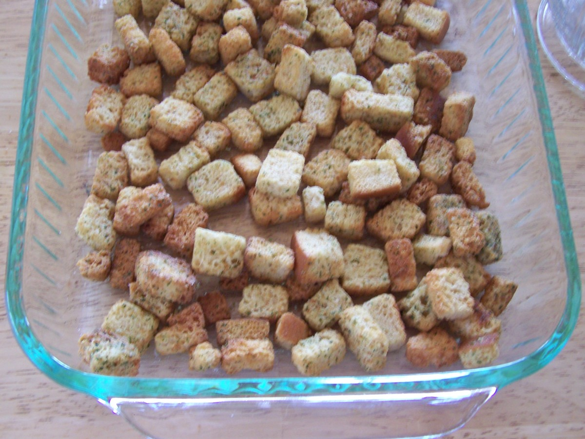 Spread croutons in the baking dish.