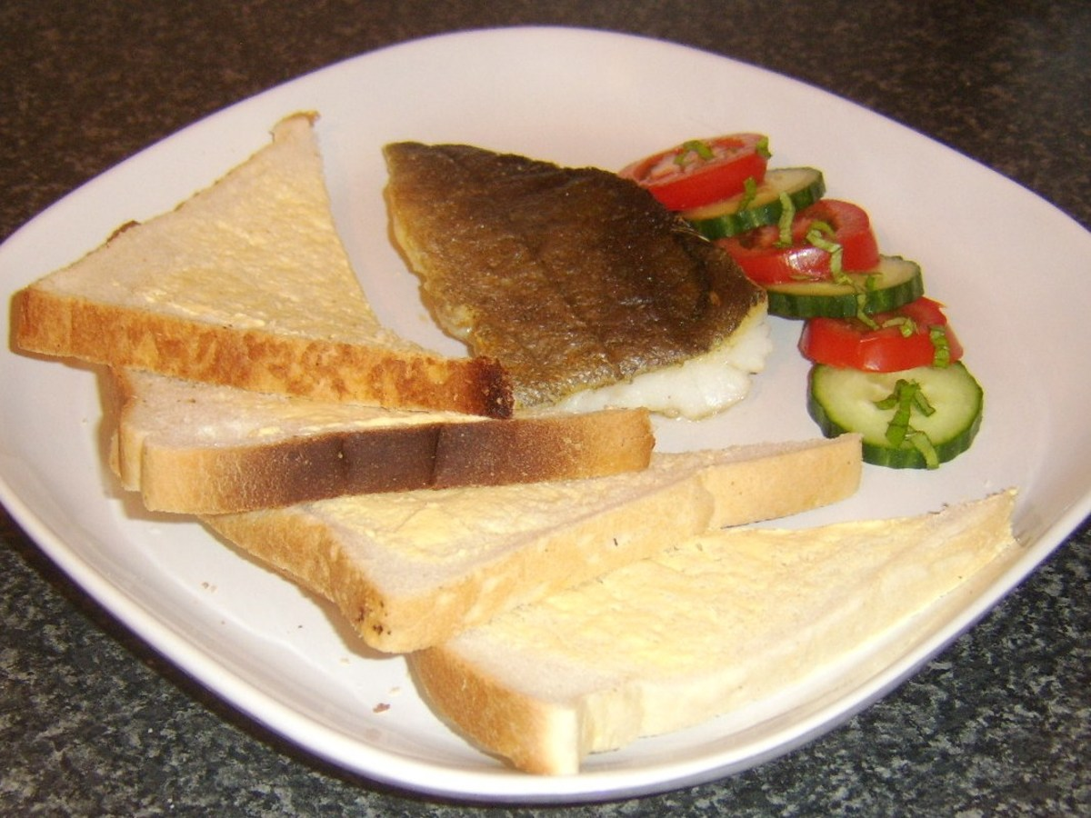 Simply fried fillet of fresh pollack served with bread, butter and salad