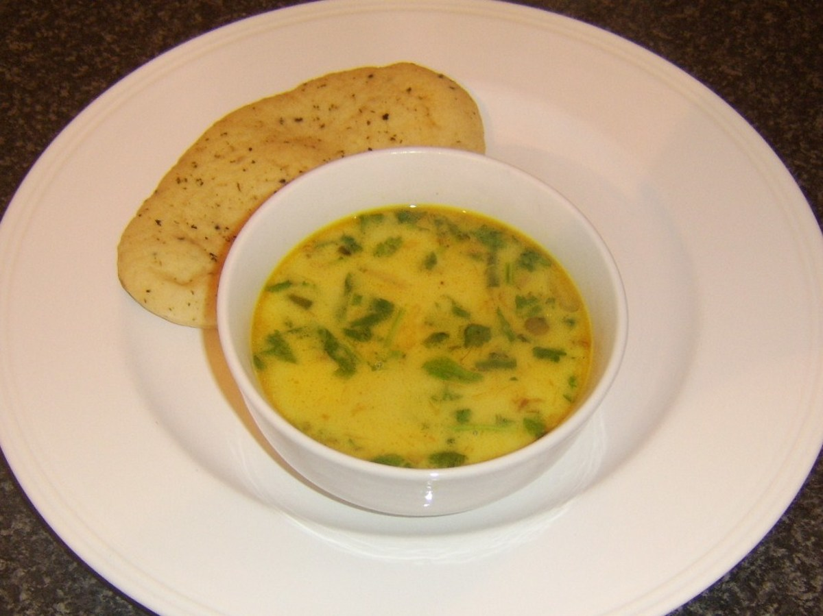 Curried pollack fish soup served with a miniature naan bread