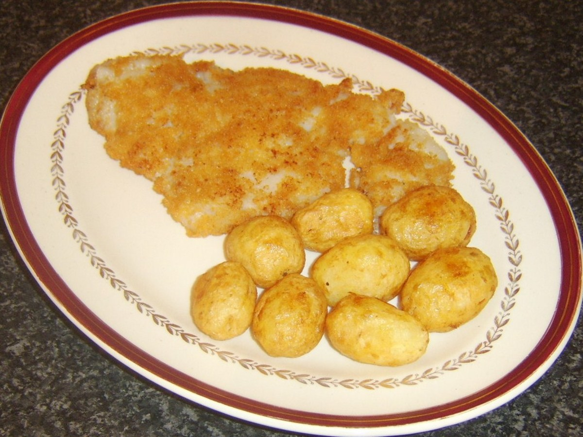 Plated breaded pollack and roast potatoes
