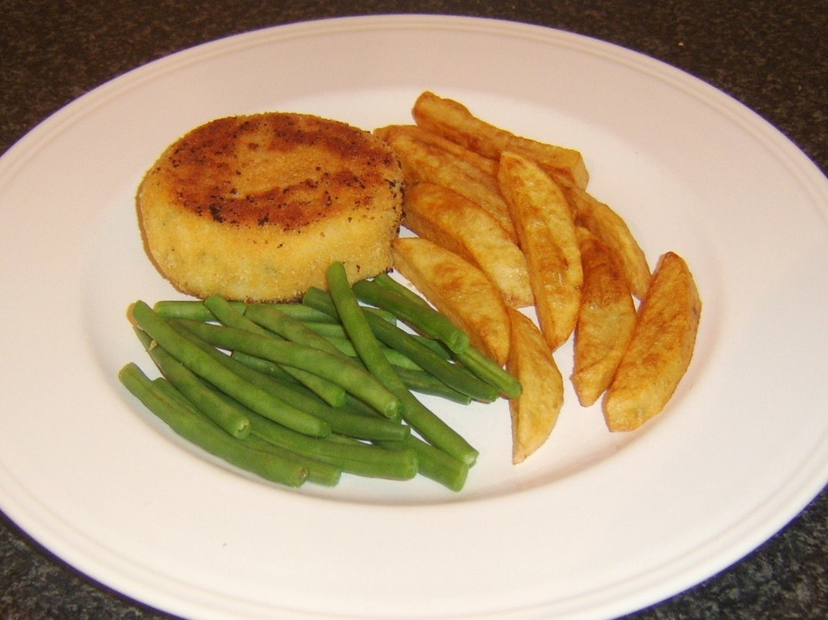 Pollack, garlic and chive fishcake served with chips and trimmed green beans