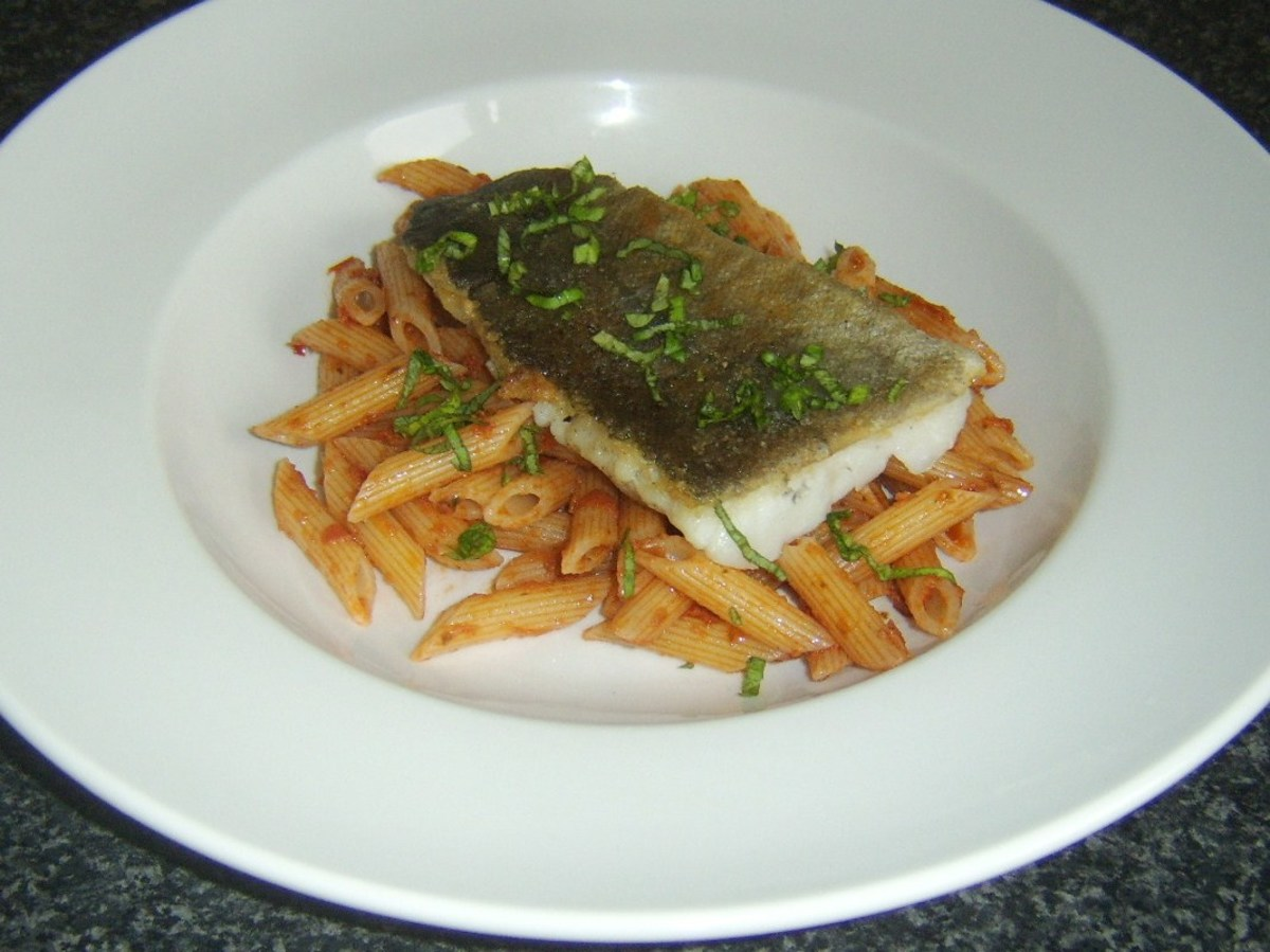 Fresh pollack fillet served on a bed of penne pasta with sun dried tomato pesto sauce
