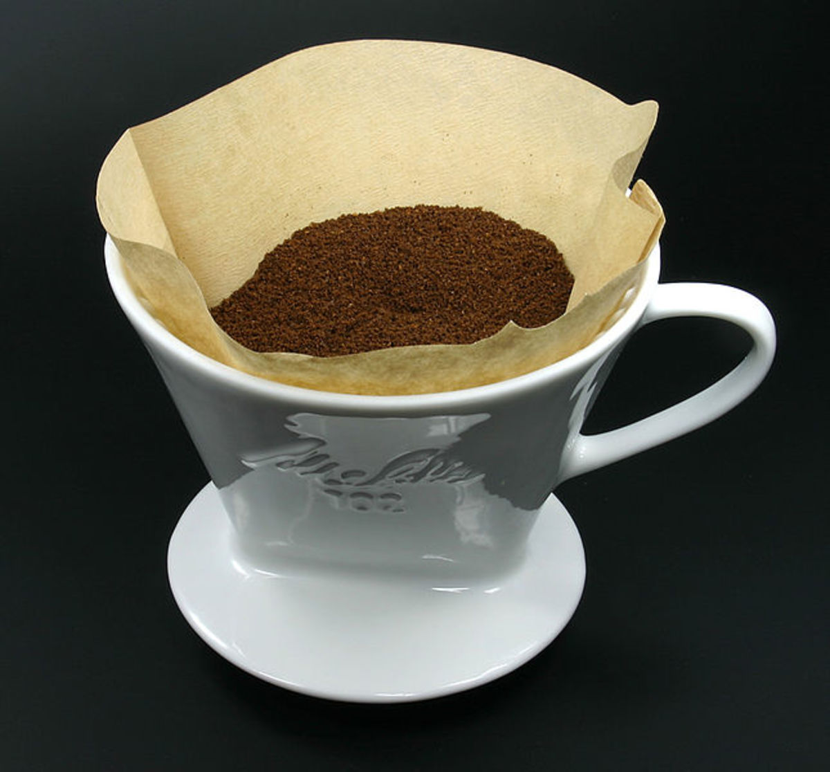 The simplest way of making drip coffee is to use a paper filter in a funnel.  You need quite a coarse grind for the method to work well.