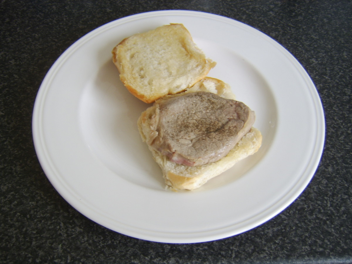 Steak is laid on base of bread roll