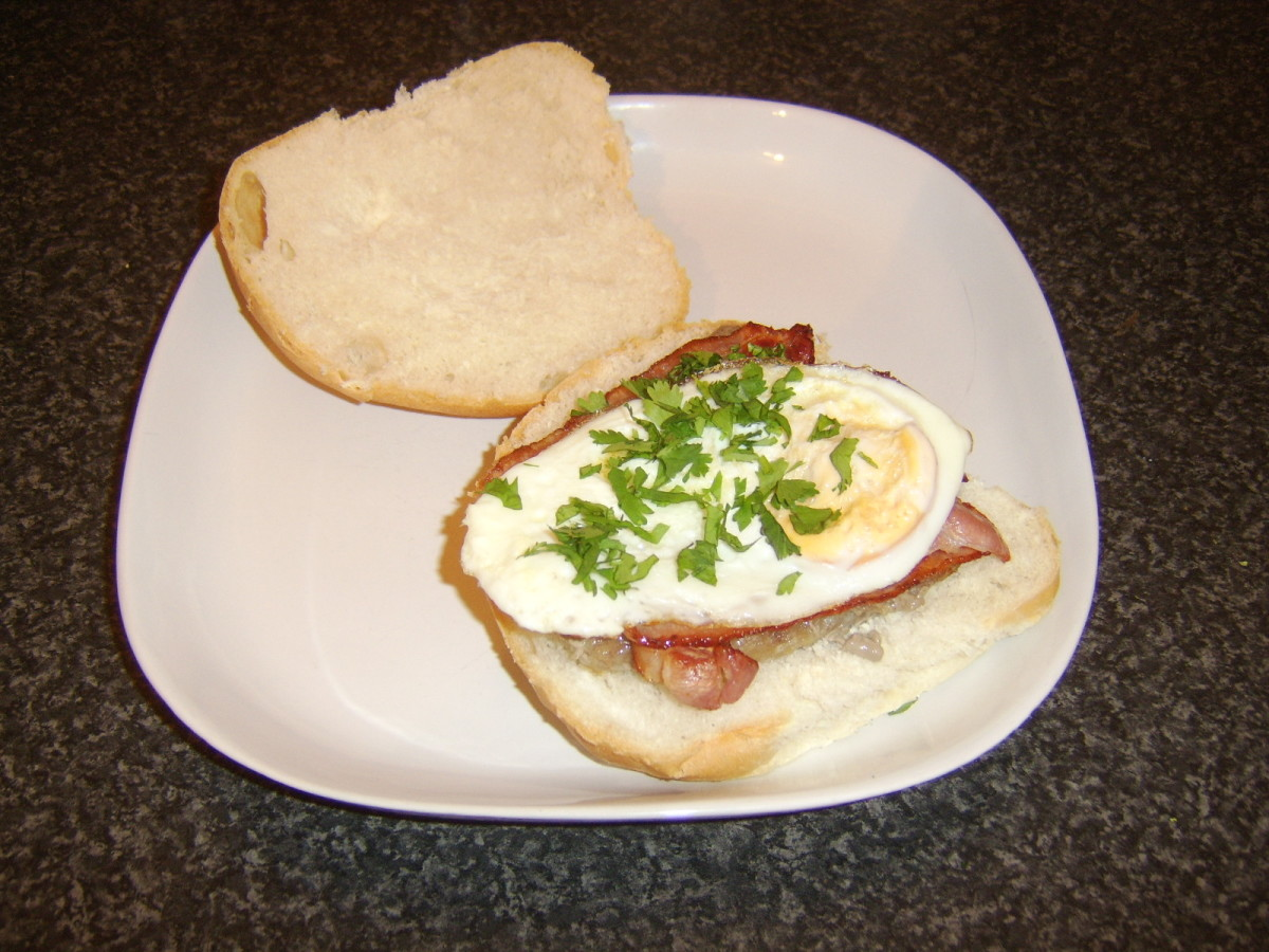 Steak, crispy bacon and fried egg sandwich