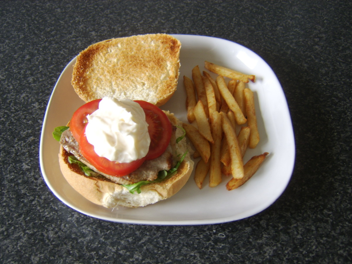 Steak, salad and garlic mayo on a toasted bread roll with homemade fries